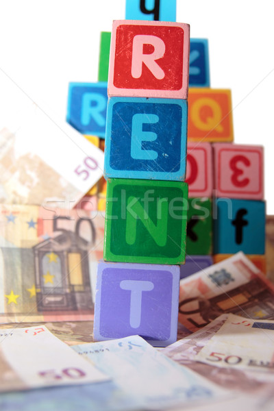 rent money in toy blocks Stock photo © morrbyte