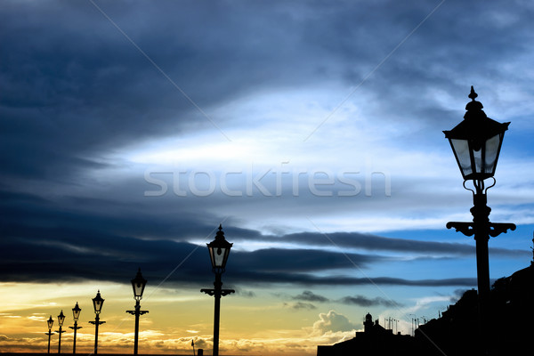 row of vintage lamps and lighthouse Stock photo © morrbyte