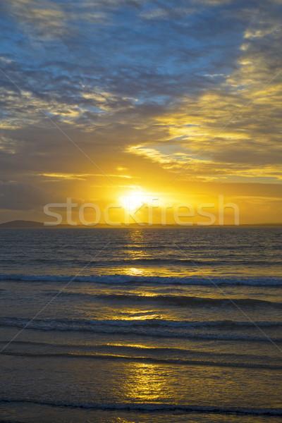 yellow sunset rays from beal beach Stock photo © morrbyte