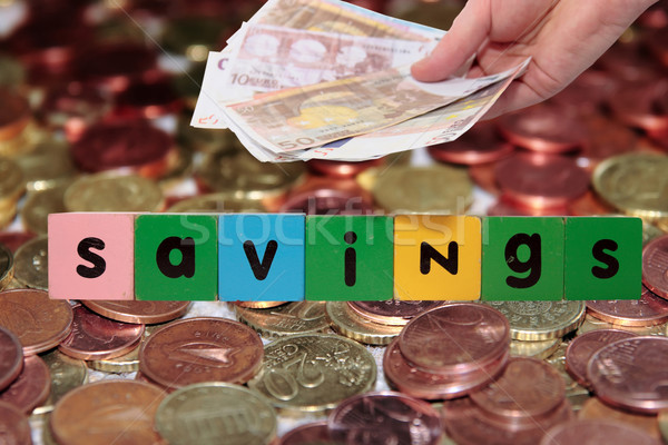 euro note and coins savings in toy letters Stock photo © morrbyte