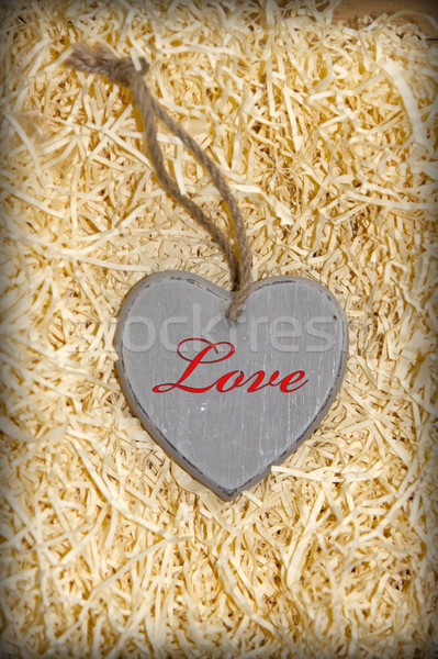 red inscribed wooden love heart in nest Stock photo © morrbyte