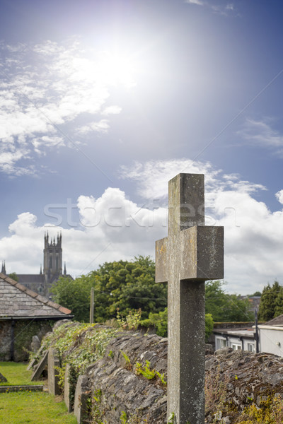 sunshine over cross at ancient graveyard Stock photo © morrbyte