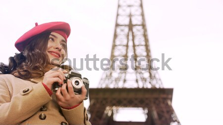 Happy lady standing under umbrella in Paris, smiling and waiting for date Stock photo © motortion