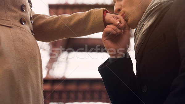 Man confessing his feelings and kissing hand to his girlfriend, standing on knee Stock photo © motortion