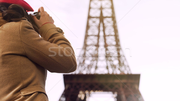 Stock photo: Female tourist photographing Eiffel Tower, spending vacation in Paris, travel