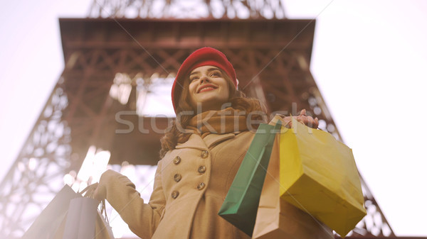 Beautiful lady having successful shopping in Paris, shopaholic with many bags Stock photo © motortion