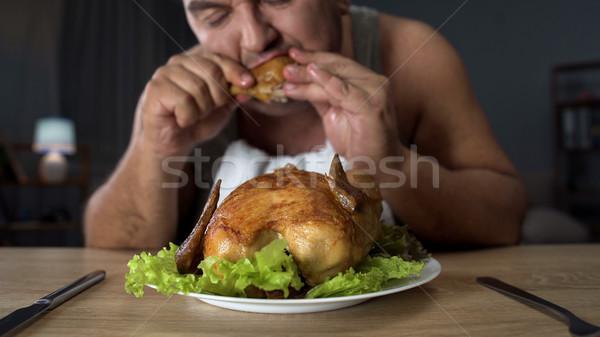 Maschio mangiare grassi alimentare dipendenza Foto d'archivio © motortion