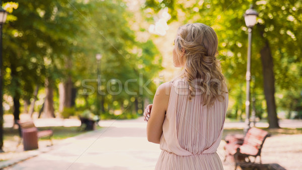 Anxious curly-haired beauty looking forward to her boyfriend, tender feelings Stock photo © motortion