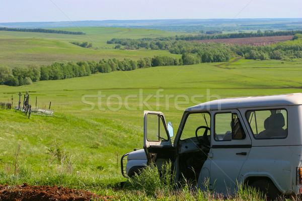 Green field and open agronomist car Stock photo © motttive