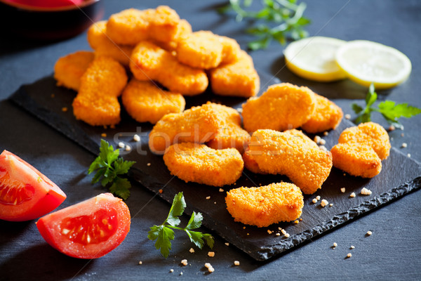 Chicken Nuggets On A Slate Plate Stock photo © mpessaris