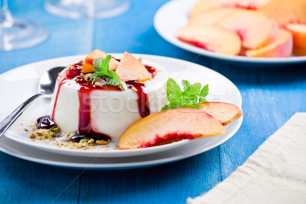 Peach Panna Cotta With Cherry Topping Stock photo © mpessaris