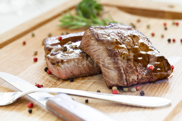 Two Tasty Steaks On a Wooden Board Stock photo © mpessaris