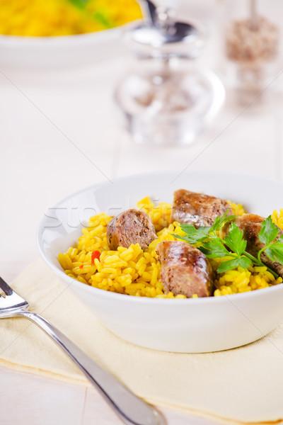 Kolbászok curry rizs közelkép fénykép étel Stock fotó © mpessaris