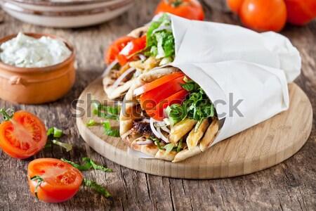 Görög disznóhús pár zöld hús saláta Stock fotó © mpessaris