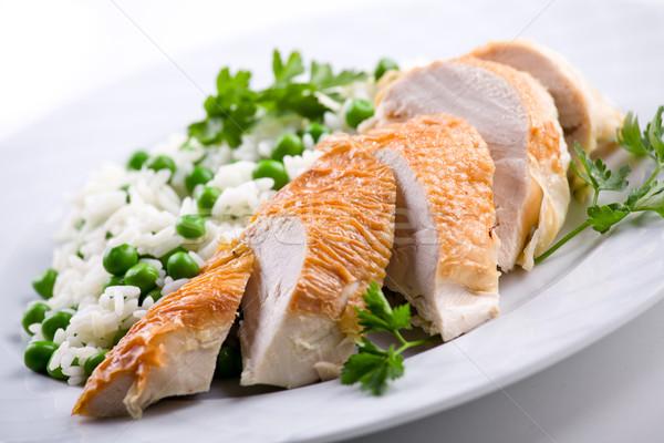 Pierś z kurczaka serwowane ryżu groszek żywności obiedzie Zdjęcia stock © mpessaris