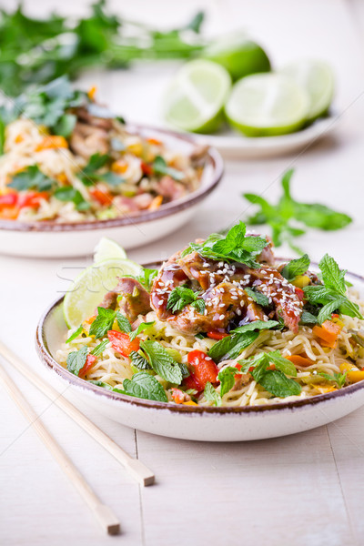 Thai Noodles With Pork And Vegetables Stock photo © mpessaris