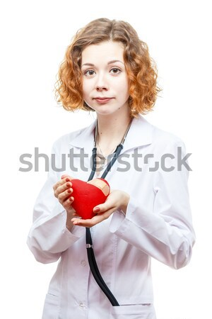 cute redhead doctor in lab coat with heart Stock photo © mrakor