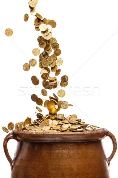 Gouden munten vallen vintage pot geïsoleerd witte Stockfoto © mrakor