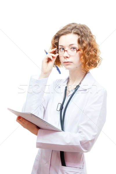 cute redhead doctor in lab coat and glasses with nothebook Stock photo © mrakor