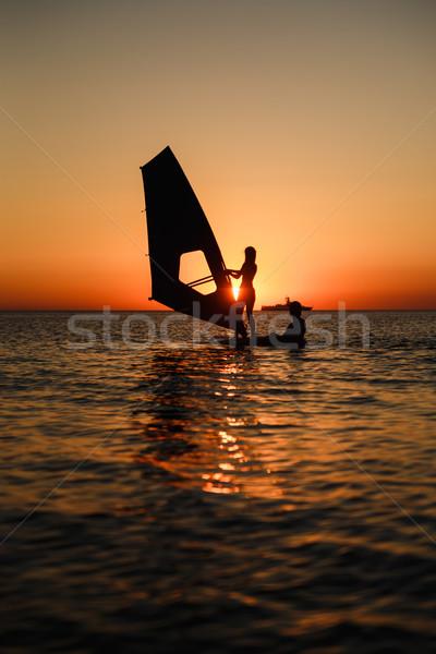 windsurfer learning silhouette against sun Stock photo © mrakor