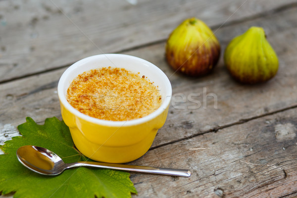 French dessert creme brulee in porcelain bowl on wooden boards Stock photo © mrakor
