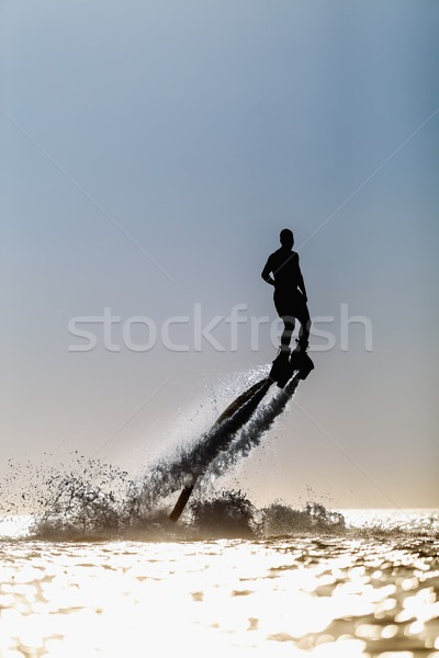 Silhouette of a fly board rider Stock photo © mrakor