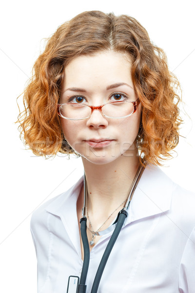 cute redhead doctor in lab coat with glasses Stock photo © mrakor
