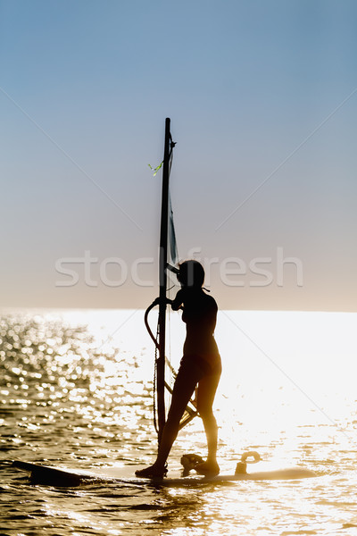 windsurfer silhouette against sun Stock photo © mrakor