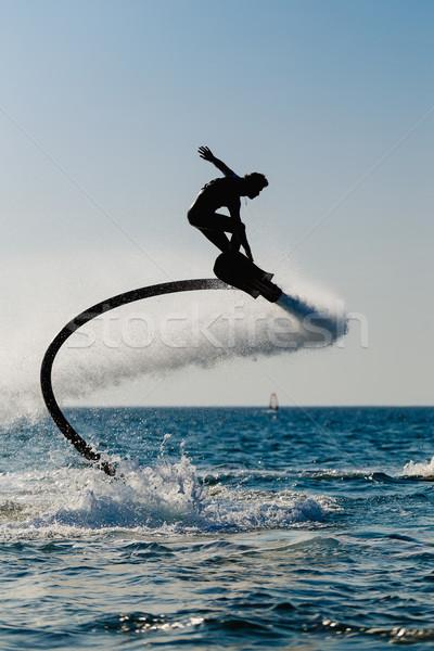 Silhouet boord strand man sport springen Stockfoto © mrakor