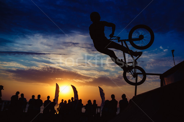 Silhouette of man doing extreme jump with bike Stock photo © mrakor