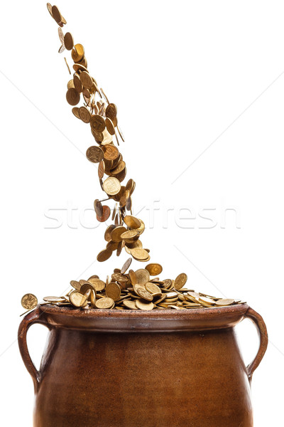gold coins falling in the vintage pot Stock photo © mrakor