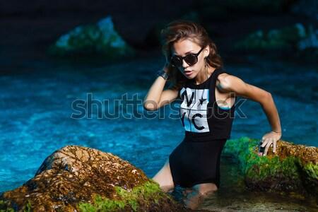 Young teen girl in sea fashion shoot at sunset beach Stock photo © mrakor