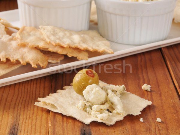 Feta cheese and olives on flatbread crackers Stock photo © MSPhotographic