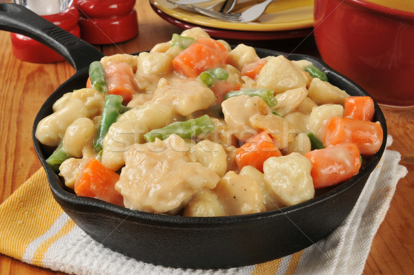 Chicken and dumplings in a cast iron skillet Stock photo © MSPhotographic