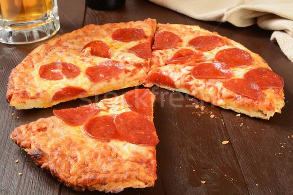 Pepperoni pizza birra briciole formaggio Foto d'archivio © MSPhotographic