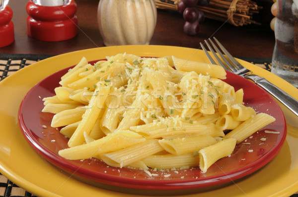 Buttered penne rigate noodles with parmesan cheese Stock photo © MSPhotographic