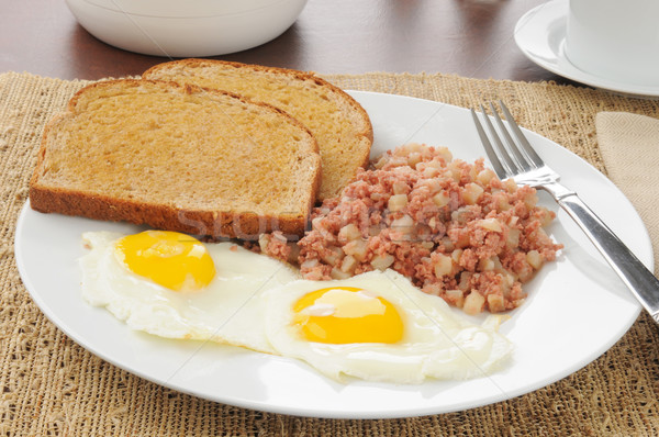 Stock photo: Corned beef hash and eggs