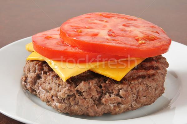Hamburger patty with tomato and cheese Stock photo © MSPhotographic