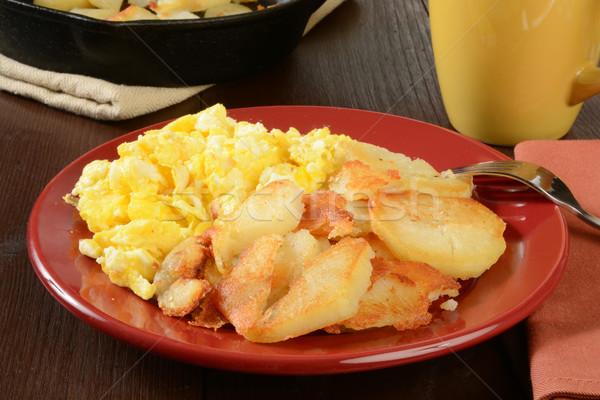 Rántotta otthon sültkrumpli sült krumpli öntöttvas Stock fotó © MSPhotographic