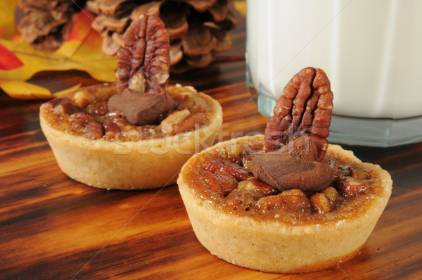 Pecan tarts with a glass of milk Stock photo © MSPhotographic