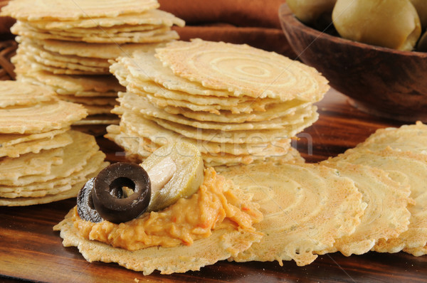 Three pepper hummus and olives on crispbread crackers Stock photo © MSPhotographic