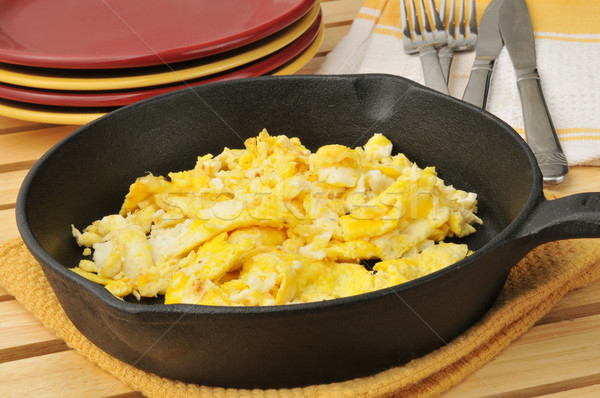 Scrambled eggs in a cast iron skillet Stock photo © MSPhotographic