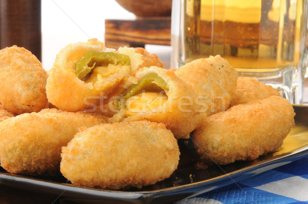 Jalapeno cheese sticks and beer Stock photo © MSPhotographic