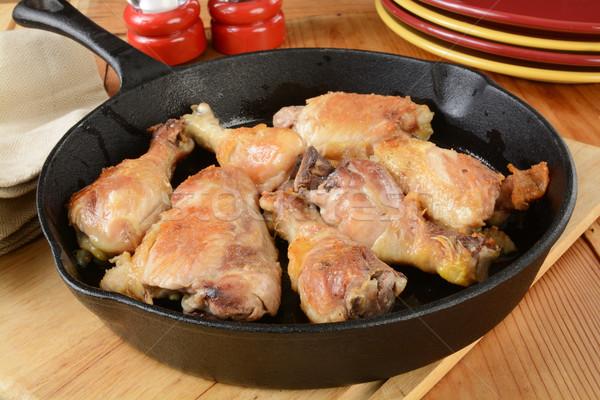 Brathähnchen Oberschenkel Gusseisen Huhn Abendessen Fleisch Stock foto © MSPhotographic