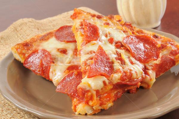Calabresa pizza queijo parmesão fatias prato refeição Foto stock © MSPhotographic