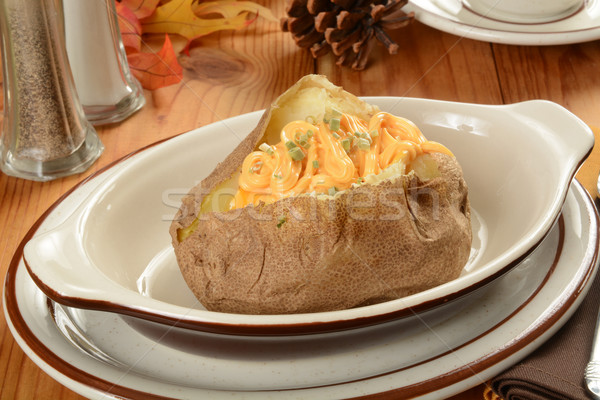 Baked potato with cheese Stock photo © MSPhotographic