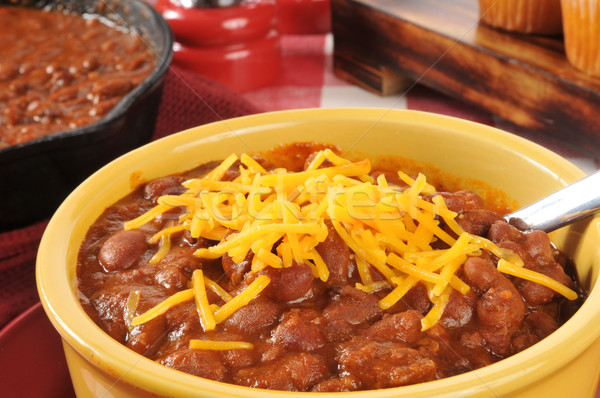Bowl of chili with cheddar cheese Stock photo © MSPhotographic