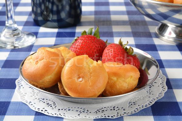 Cream puffs and strawberries Stock photo © MSPhotographic