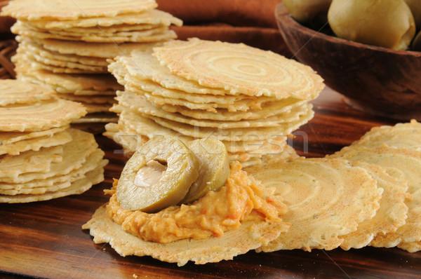 Hummus and green olives on crispbread crackers Stock photo © MSPhotographic