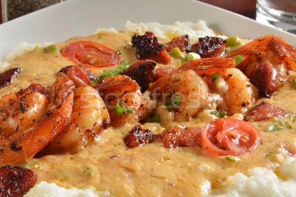 Cajun crevettes beurre sauce poivrons légumes Photo stock © MSPhotographic